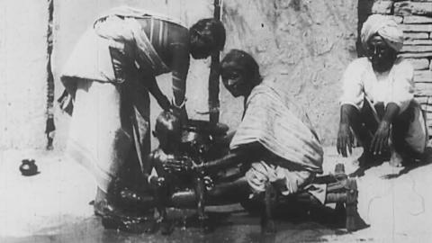 An Indian Washing the Baby