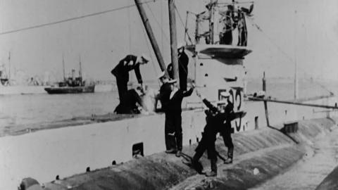 Lowering Torpedo into Submarine E. 23