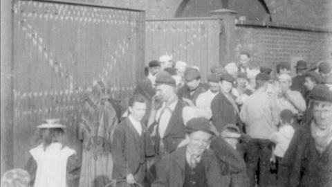 Workmen Leaving Peacock's Works at Meal Time, Gorton, Manchester (1900)