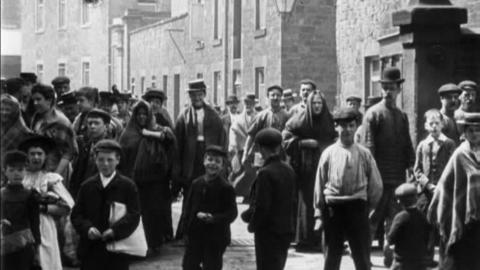 Mill Workers Leaving Oldroyd & Sons Mill, Dewsbury (1900)
