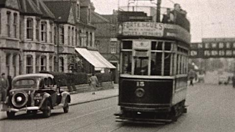 Reading: Vincent's Garage being built and trams