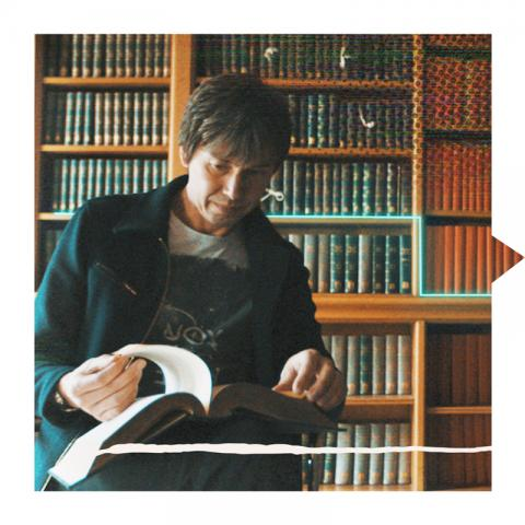 Brian Cox reading in library